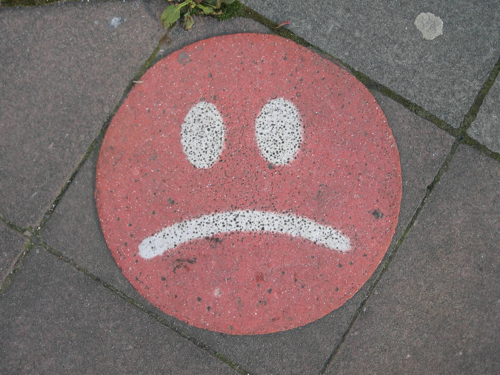 sad face on concrete