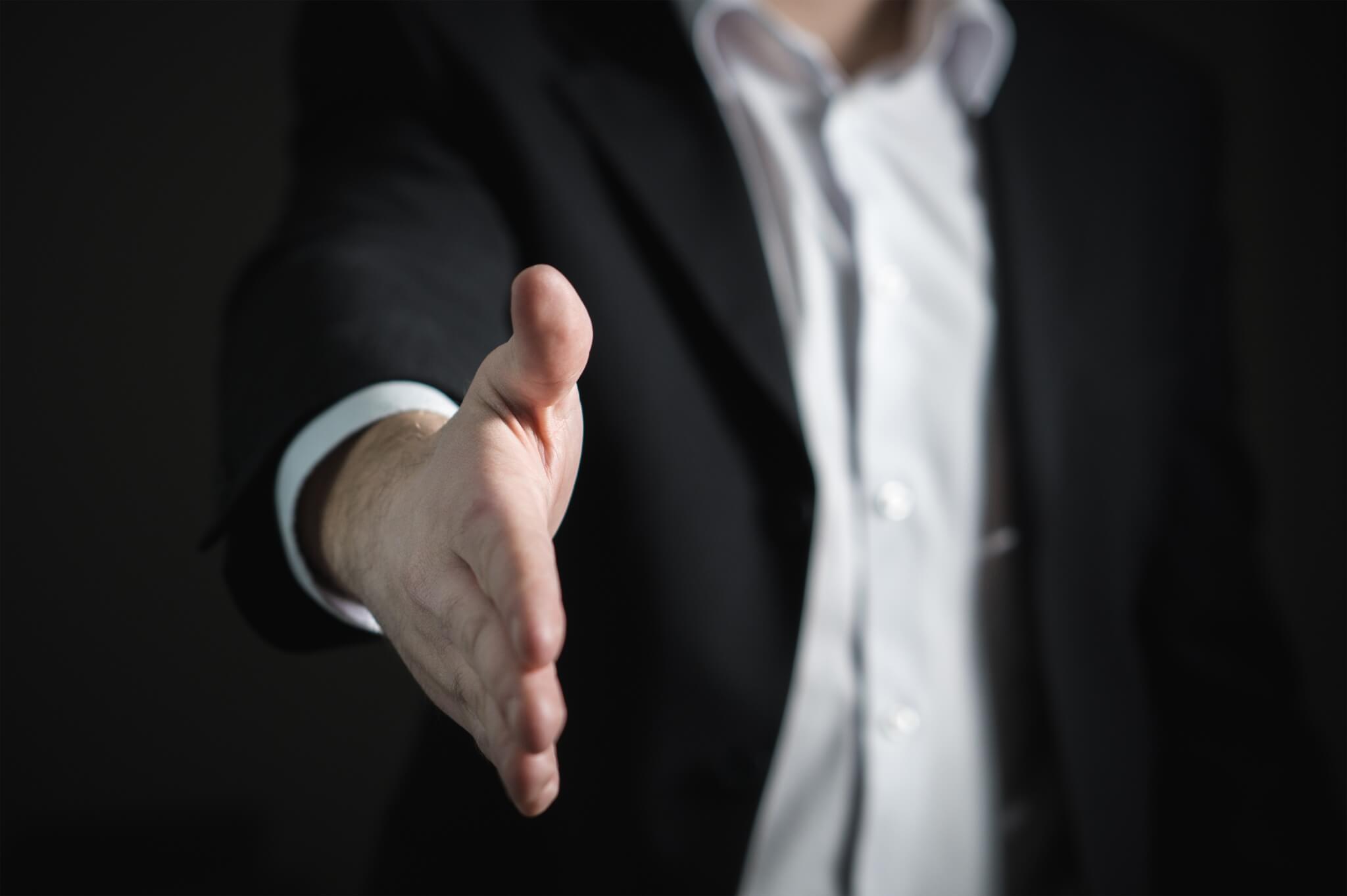 hand extended for handshake